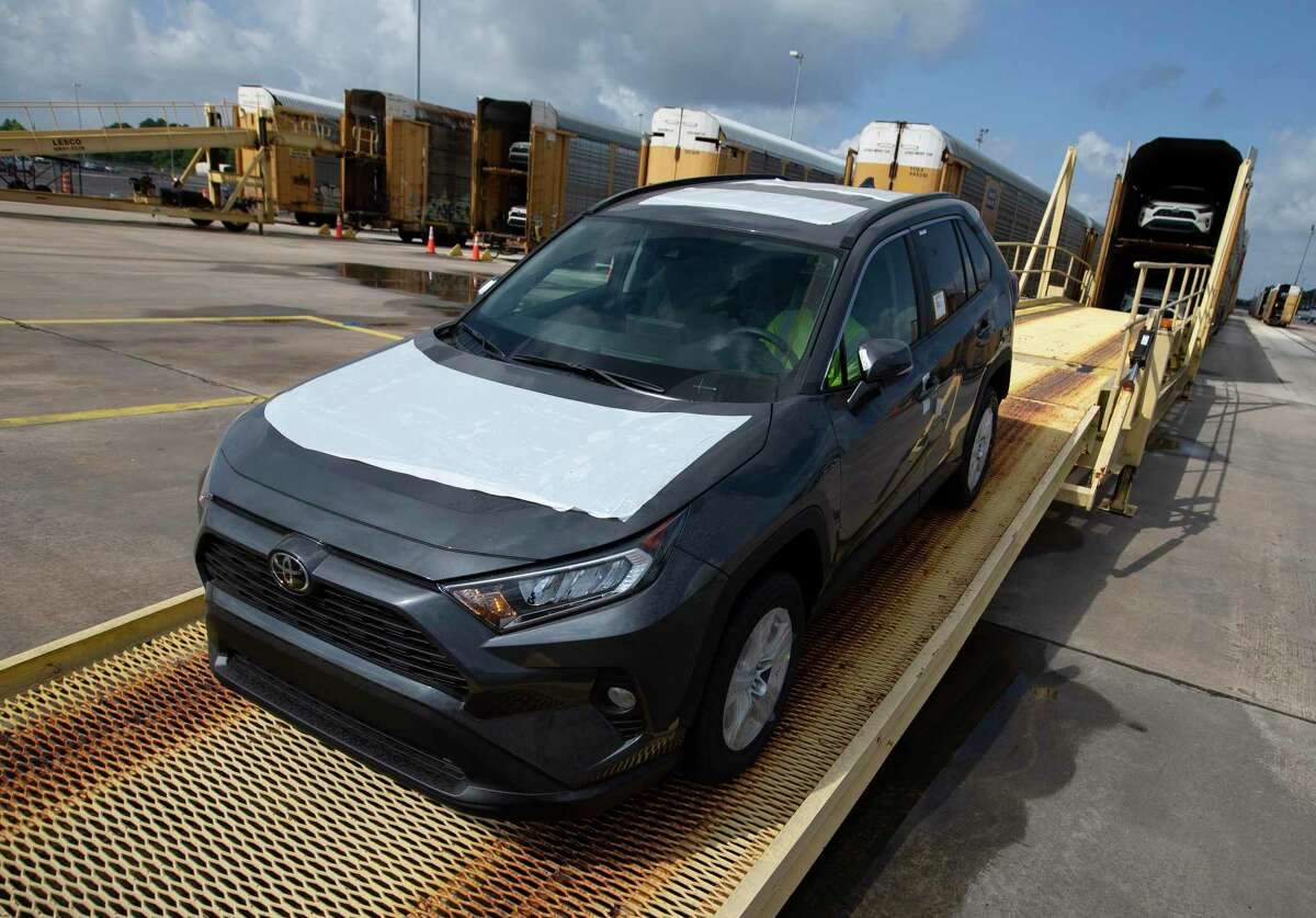 Gulf States Toyota staff rail offloading vehicles arrived via frieght train Wednesday, May 26, 2021, in Houston.