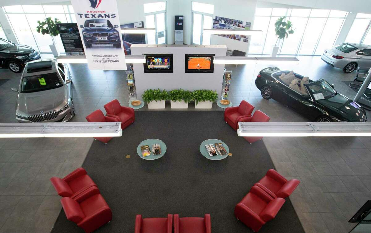 Vehicles are on display at Advantage BMW Midtown show room Wednesday, June 2, 2021, in Houston. Group 1 Automotive landed among the top of Houston's most profitable companies last year.