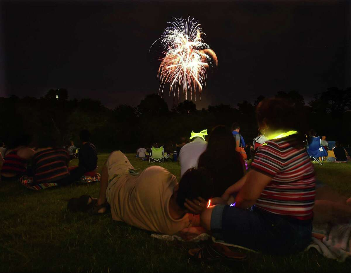 Area residents view the city of New Haven's fireworks display from East Rock at the football field at Wilbur Cross High School on Independence Day, Monday, July 4, 2016. (Catherine Avalone/New Haven Register)