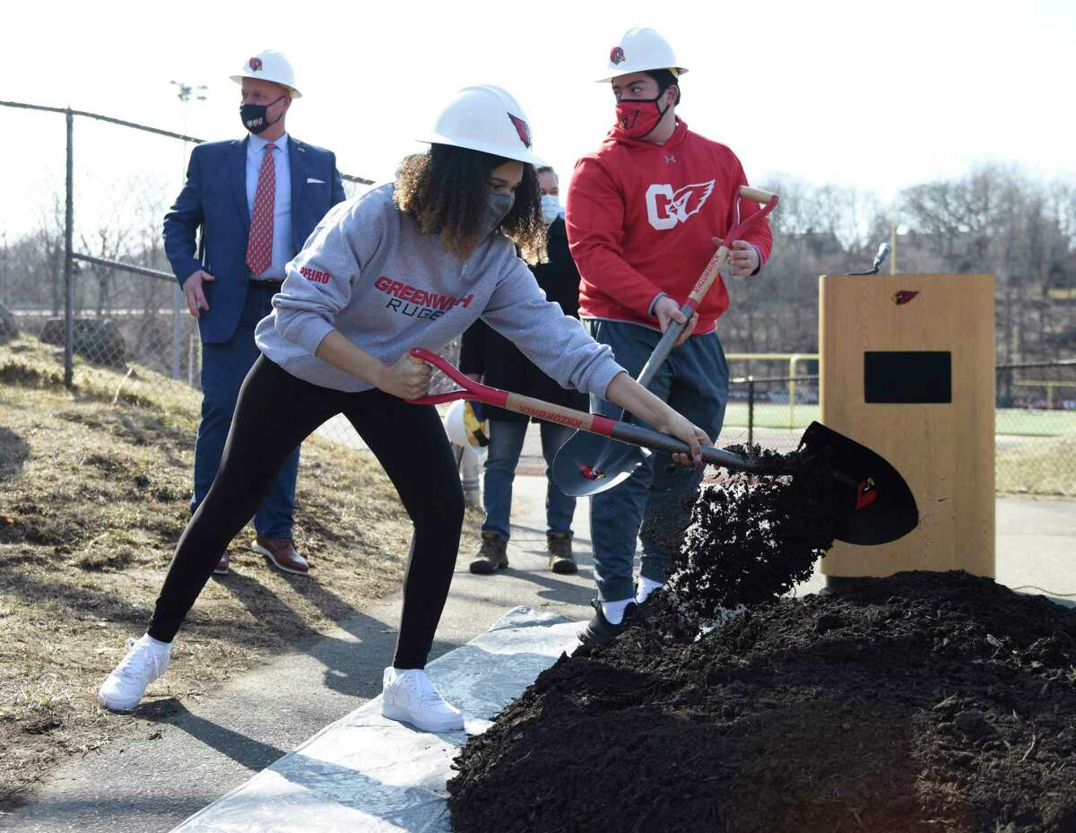GHS student athletes participate in the groundbreaking for the improvements to Cardinal Stadium at Greenwich High School in Greenwich, Conn. Wednesday, March 10, 2021. Oversight of the project has been a major concern of the RTM's District 9 and on Monday night it successfully pushed through a change to town code requiring buiding committees for most future Board of Education projects.