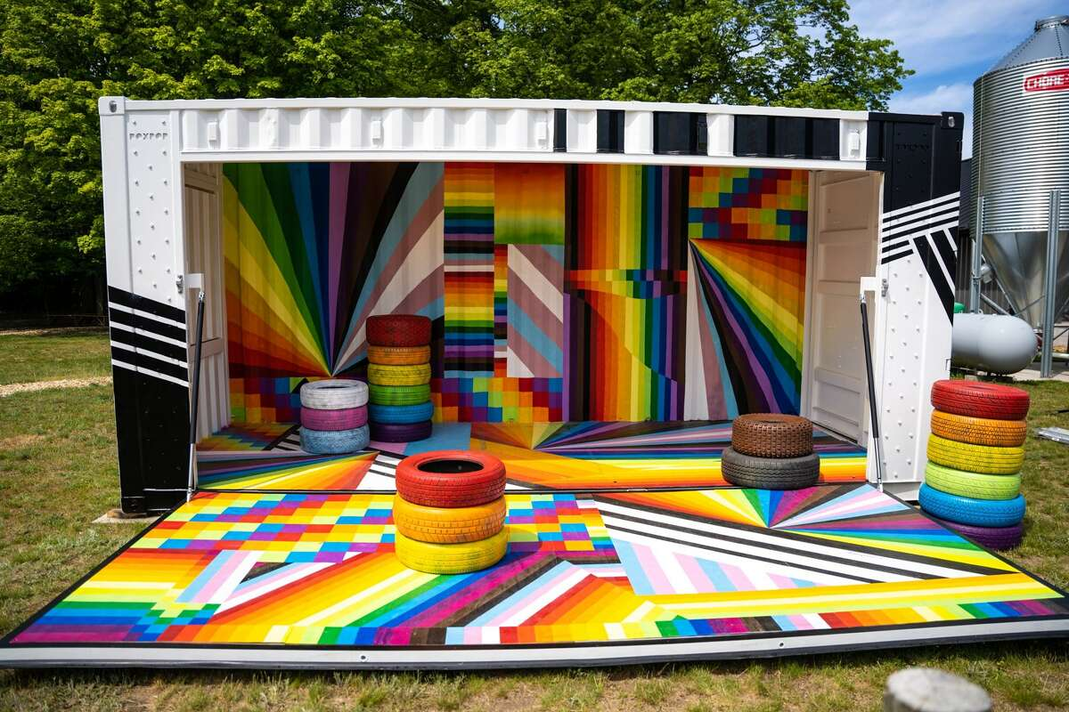 A brightly painted Britten BoxPop shipping container is on display at Iron Fish Distillery as part of three pride art installations for Pride Month.