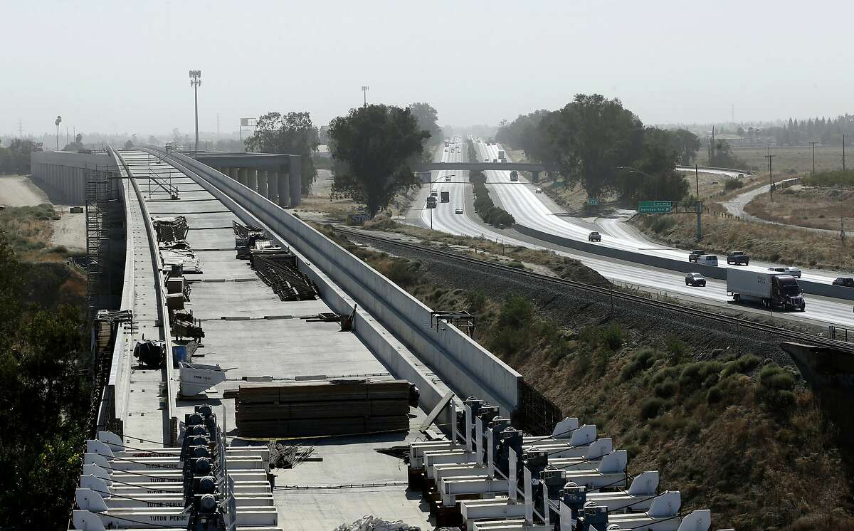 A high-speed rail viaduct is under construction for California's troubled bullet train paralleling Highway 99 near Fresno.