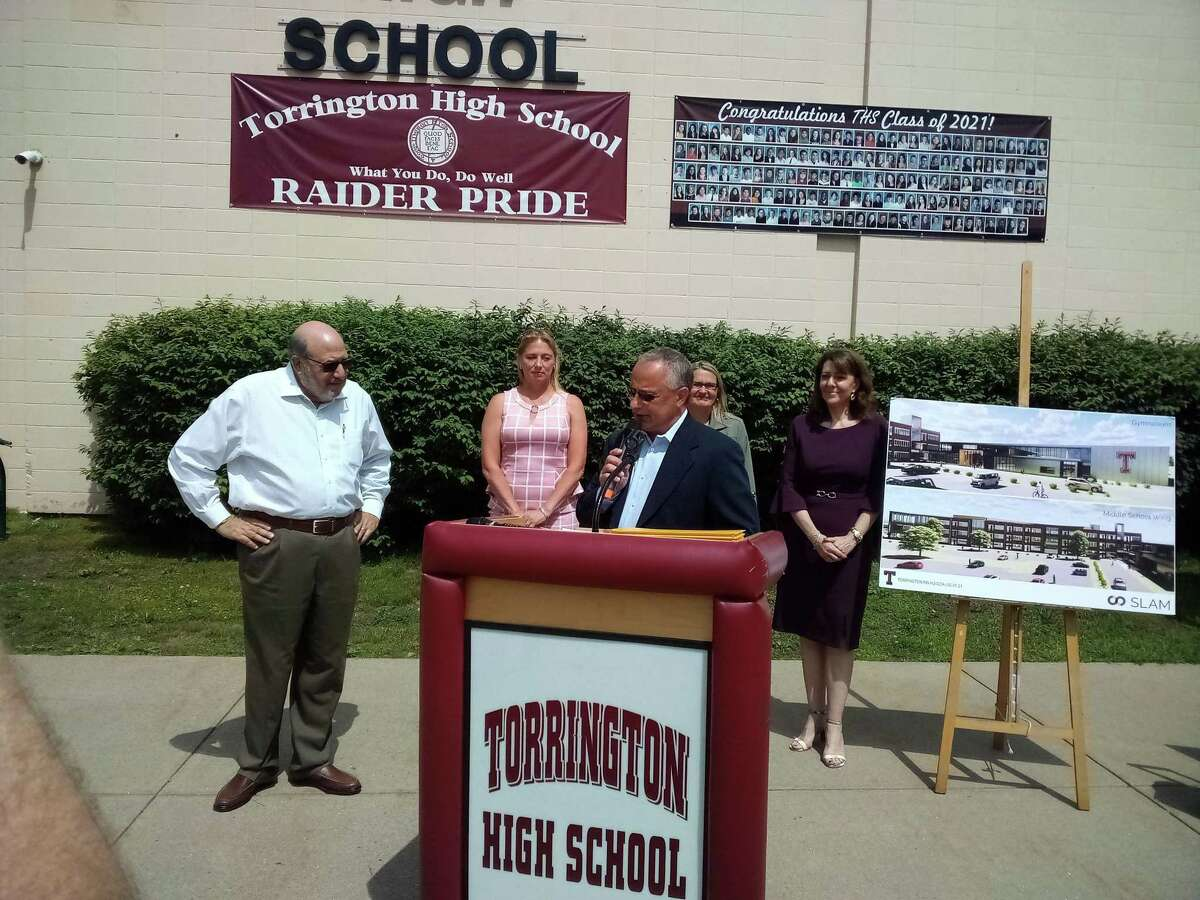 Torrington School Building Committee's Mario Longobucco speaks about the project's funding during a press conference Tuesday morning at Torrington High School.
