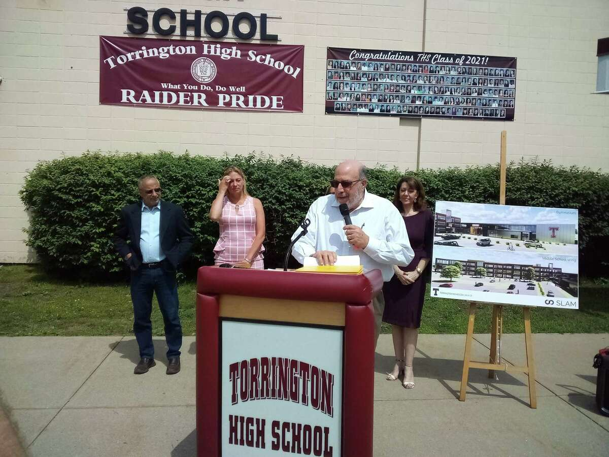 Torrington School Building Committee chairman Ed Arum speaks about the project's funding during a press conference Tuesday morning at Torrington High School.
