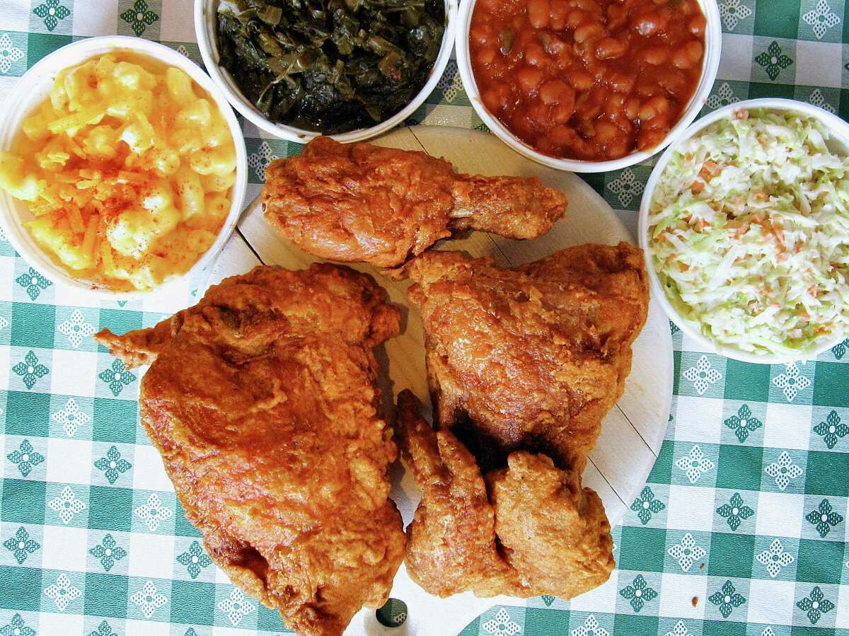 A plate of fried chicken with sides from the Austin location of Gus's World Famous Fried Chicken.