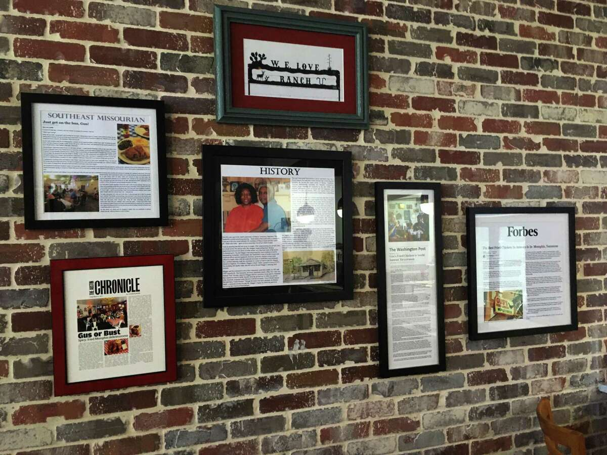 Various press from national media outlets adorn the walls at Gus's World Famous Fried Chicken.
