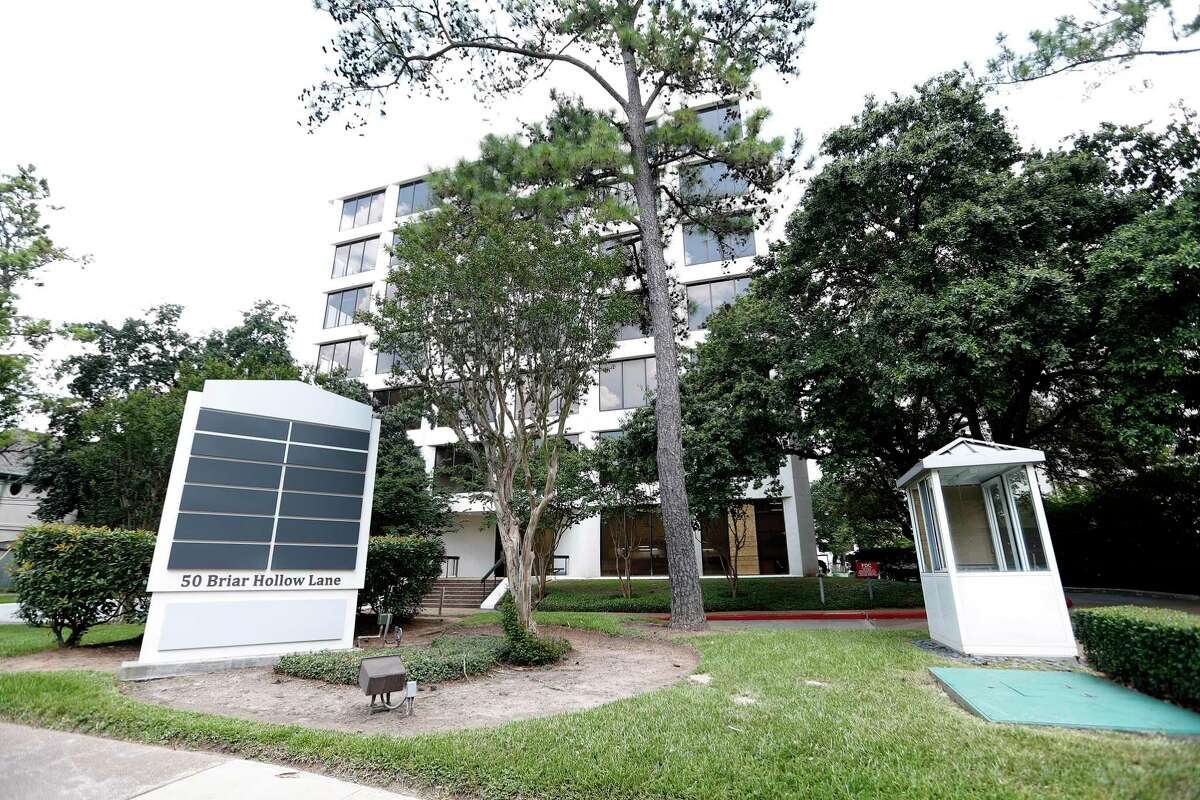 The building at 50 Briar Hollow Lane, Tuesday, June 15, 2021, in Houston. The owner of a pair of office buildings in Uptown Houston that are on the selling block after the pandemic caused their vacancy rates to soar is advertising that he will accept Bitcoin offers. Accepting cryptocurrency is a marketing tactic has been used to garner attention to properties in other markets, but it also poses a risk - the value of Bitcoin has fluctuated drastically over the past year, with one Bitcoin being worth anywhere from $8,815 to $64,899.