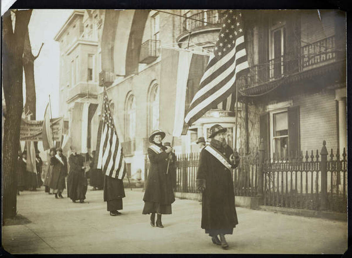 """In this photograph, women suffragists march. This piece is part of """"Voices and Votes: Democracy in America,"""" a traveling exhibit that is part of the Smithsonian Institution's """"Museum on Main Streets"""" program. The exhibit is set to appear in the atrium of the Madison County Administration Building July 17-Aug. 21."""