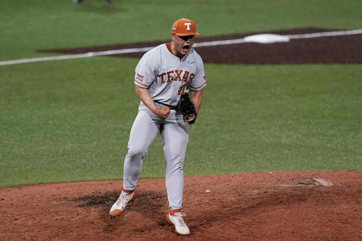 Texas pitcher Aaron Nixon celebrates after the final out in the team's win over South Florida in an NCAA Super Regional college baseball game, Sunday, June 13, 2021, in Austin, Texas. (AP Photo/Eric Gay)