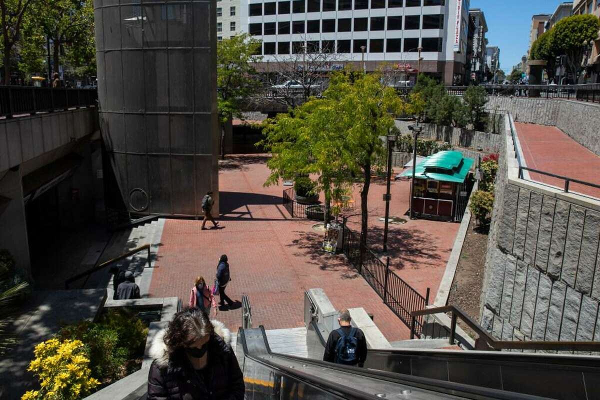 People walk through Hallidie Plaza near the Powell Street cable car turnaround at Market Street in San Francisco, Calif. Tuesday, June 8, 2021. Hallidie Plaza is slated to be the focus of yet another city upgrade effort, at least the fourth in 20 years.