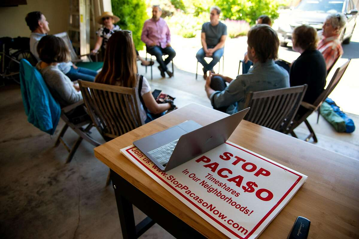 Residents of Old Winery Court meet in Tricia Smith and Tom Theodores's garage to organize against the start up company Pacaso, which purchased a house on their street, in Sonoma.