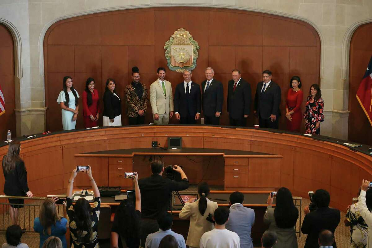 San Antonio Mayor Ron Nirenberg, center, poses with the new City Council during the formal portrait after a swearing-in ceremony, Tuesday, June 15, 2021.