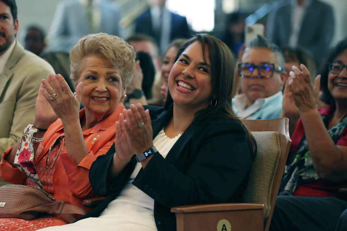 Newly elected San Antonio District 3 Council member Phyllis Viagran reacts after she is introduced to the crowd during a swearing-in ceremony in Chambers, Tuesday, June 15, 2021. Her mother, Becky Viagran, is on the left. Viagran took the place of her sister, Rebecca J. Viagran, who termed out.