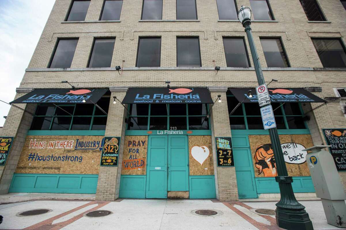 Businesses around the city closed and boarded up due to the pandemic.