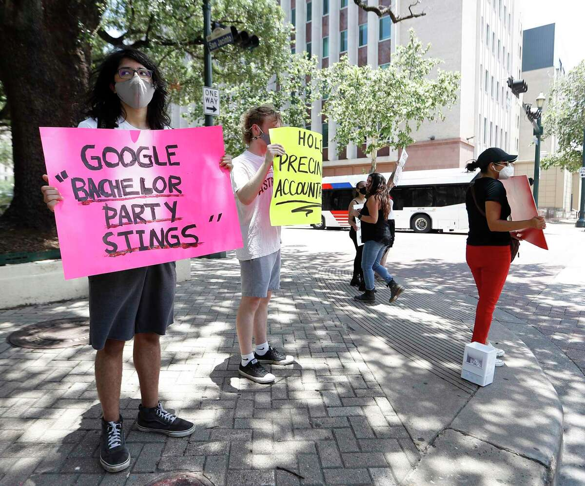 """Protesters with the group The Age of Change, protest as they want the Harris County Precinct 1's Human Trafficking Unit, Constable Alan Rosen, and Assistant Chief Chris Gore held accountable for the """"bachelor party"""" stings, in front of the 1910 Harris County Courthouse, Tuesday, June 8, 2021, in Houston."""