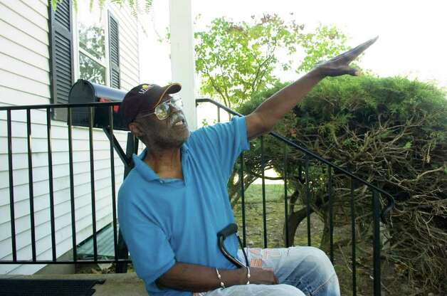 President Sylvester Wilson keeps an eye on things in Sylvan Knoll Co-op from his stoop Monday, September 13, 2010. Photo: Keelin Daly / Stamford Advocate
