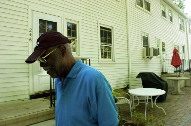 Sylvester Wilson, President of Sylvan Knoll Co-op, walks through the neighborhood Monday, September 13, 2010. Photo: Keelin Daly / Stamford Advocate