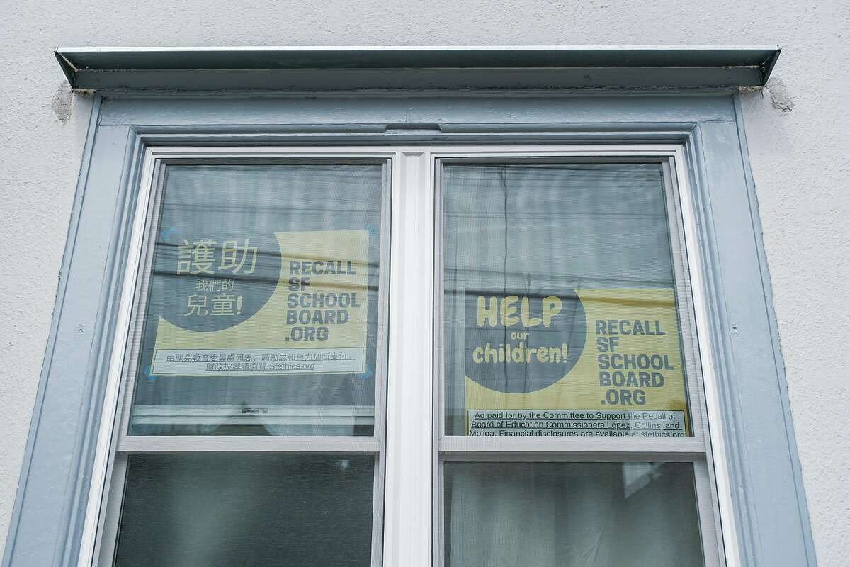 Posters promoting the recall of the school board are displayed in the window of Kit Lam's San Francisco home. Lam is at the center of a video making the rounds on Twitter showing a man allegedly stealing petitions from someone gathering signatures to recall the school board.