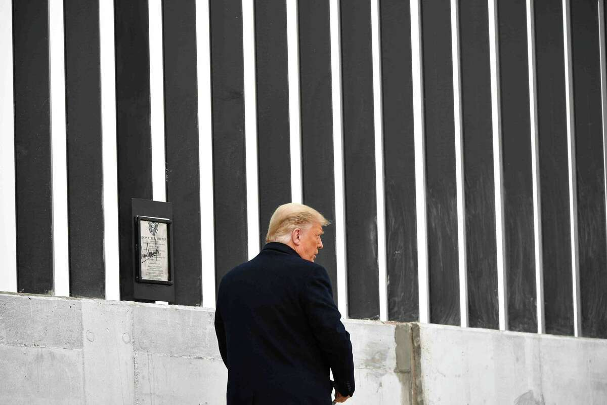 (FILES) In this file photo taken on January 12, 2021 US President Donald Trump signs a plaque as he tours a section of the border wall in Alamo, Texas. - Former US president Donald Trump announced June 15, 2021 that he will visit the US border with Mexico in a move to contrast his tough stance against immigration with successor Joe Biden's more humane approach. (Photo by MANDEL NGAN / AFP) (Photo by MANDEL NGAN/AFP via Getty Images)