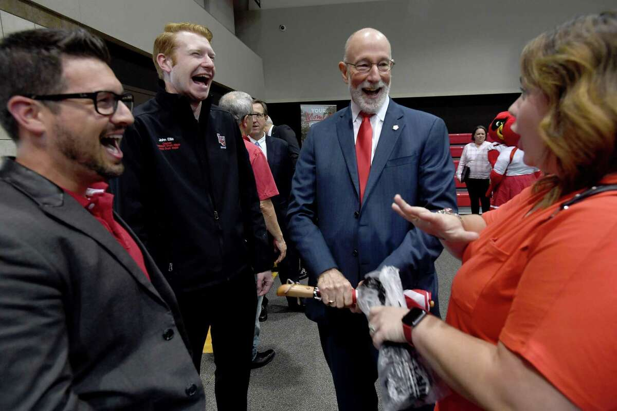 Dr. Ken Evans, President of Lamar University, jokes with (from left) Aron Arceneaux, John Ellis and Mandy Arceneaux during a goodbye party held in his honor Friday at the McDonald Gym. Evans served the campus and community for 8 years, and will leave to take a new position in Oklahoma starting in July. Photo made Friday, June 4, 2021 Kim Brent/The Enterprise