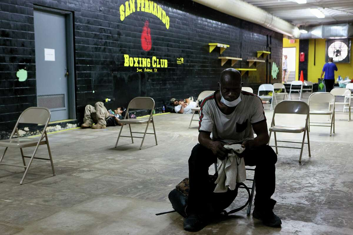 Alto Shuler, front, gets a break from the heat at the San Fernando Gym's cooling center at 319 W. Travis on Tuesday.