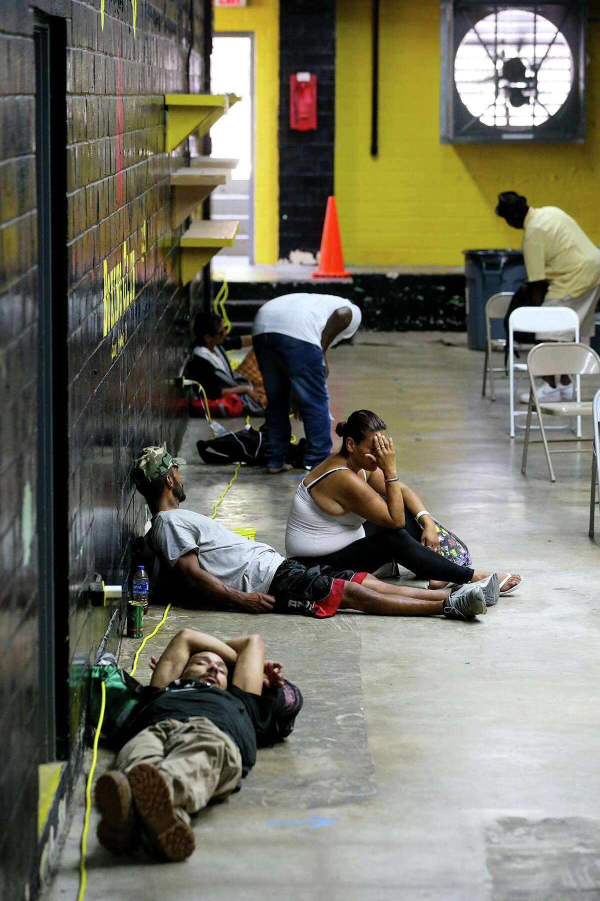 People sought refuge from the heat at the San Fernando Gym's cooling center at 319 W. Travis on Tuesday.