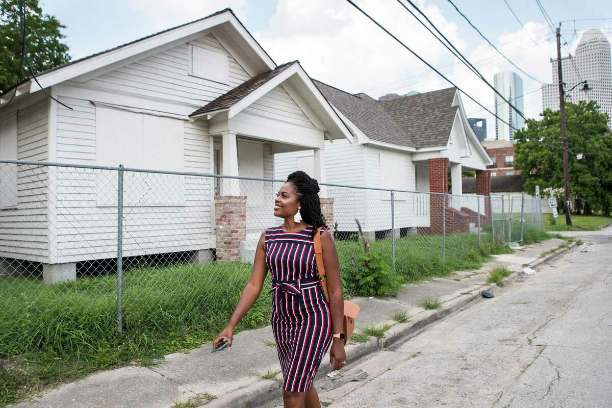 Zion Escobar, executive director of Houston Freedmen's Town Conservancy, walks past the future home of the Freedmen's Town Visitor Center Tuesday, June 15, 2021 in Houston. Houston City Council is voting Wednesday whether to designate Freedmen's Town a Heritage District, permitting nonprofits to fund improvements in the district.