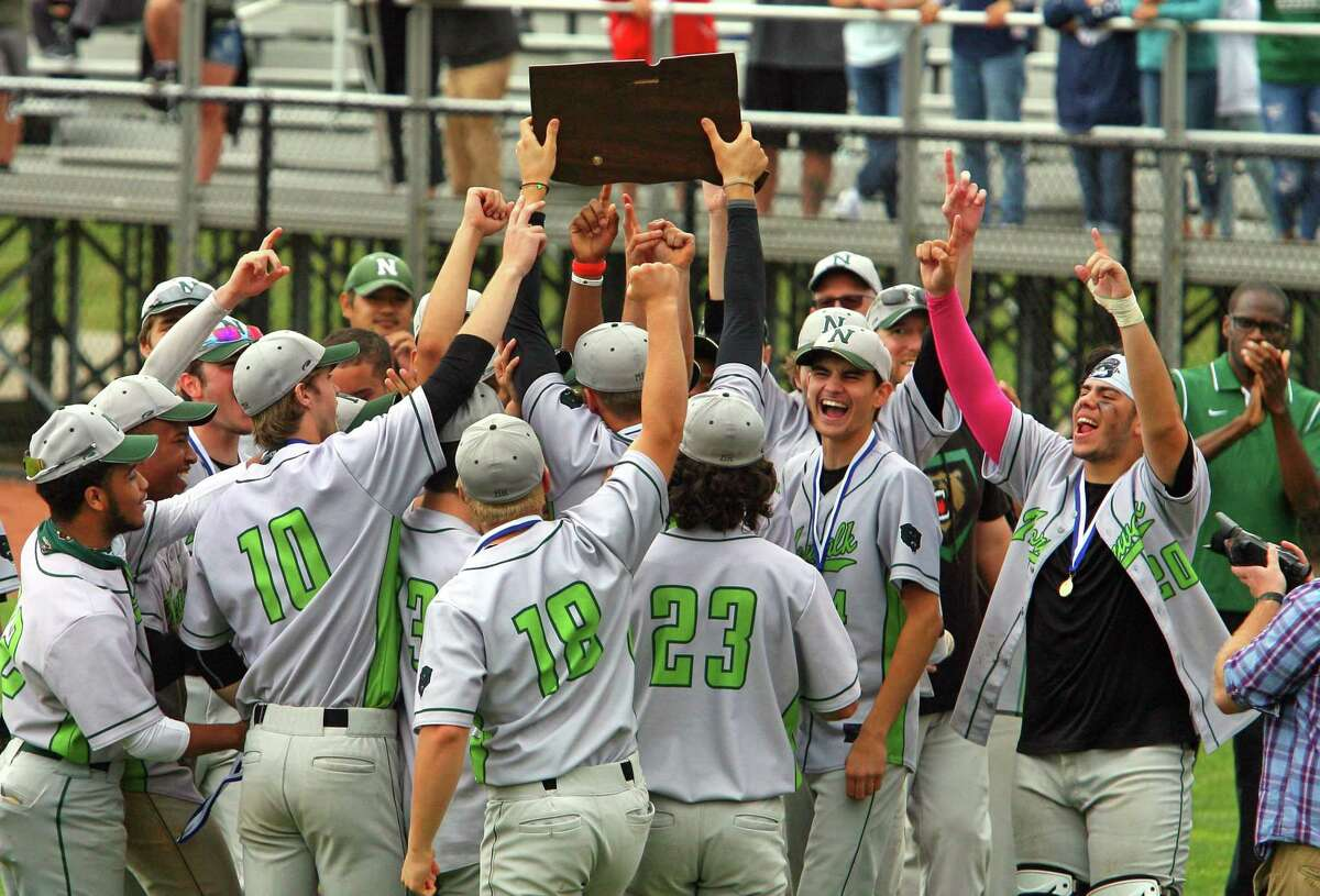 Norwalk celebrates its win over Westhill in the Class LL state championship on Saturday at Palmer Field in Middletown.