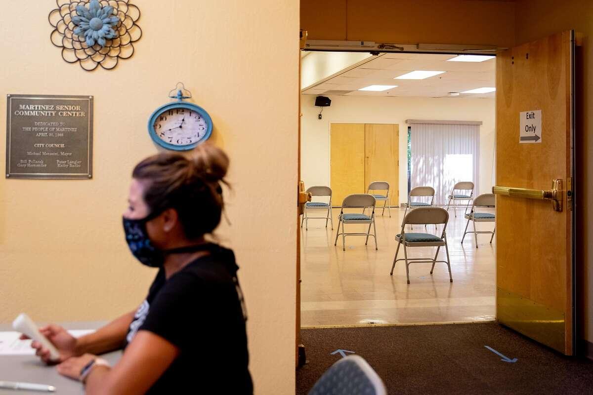 Martinez Senior Community Center supervisor Gina Gravert works the front desk while checking in residents to the cooling center inside Martinez Senior Community Center in Martinez, Calif. Saturday, August 15, 2020.