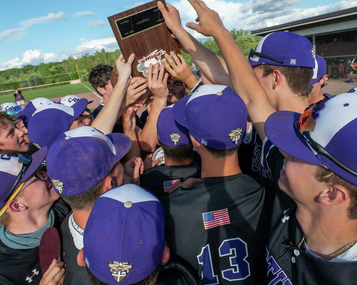 Christian Brothers Academy hoist the championship plaque after beating Shaker and winning the Class AA baseball finals at CBA in Colonie, NY, on Tuesday, June 15, 2021 (Jim Franco/Special to the Times Union)