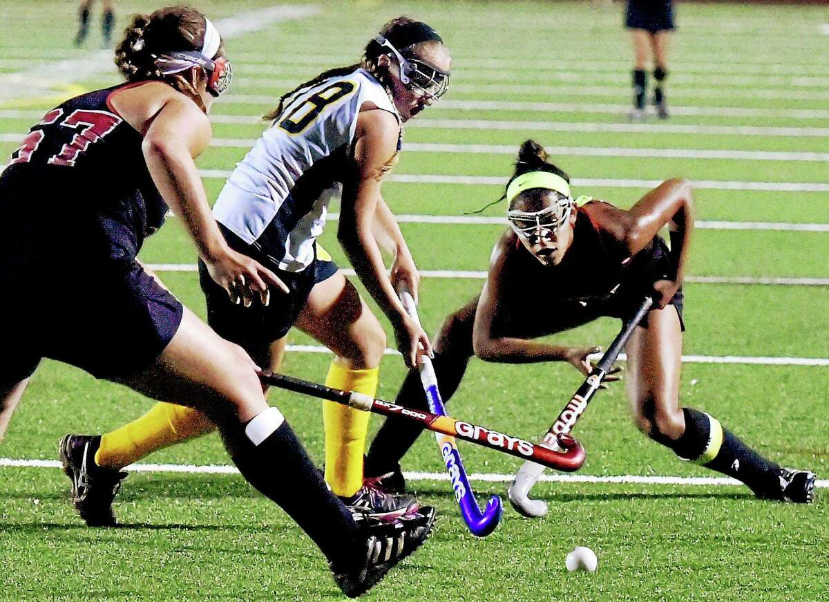 Cheshire's Sara Como, left, and teammate Kya O'Donnell, right, battle for ball with Hand's Lia Giesin 2014.
