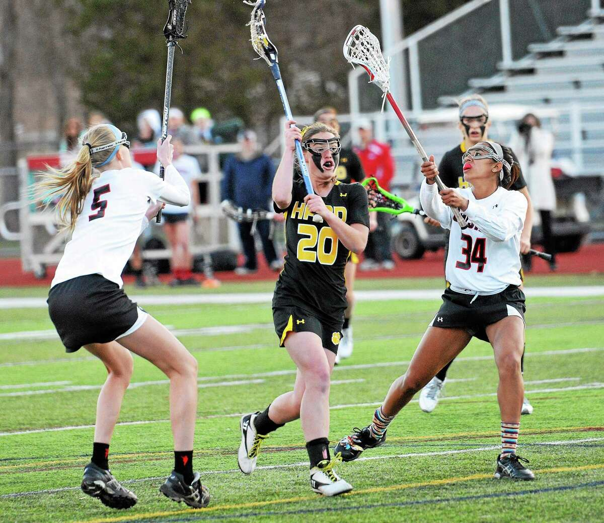 Hand's Lauren Cole takes a shot a goal as Cheshire's Erica Stauffer, left, and Kya O'Donnell defend in 2014.