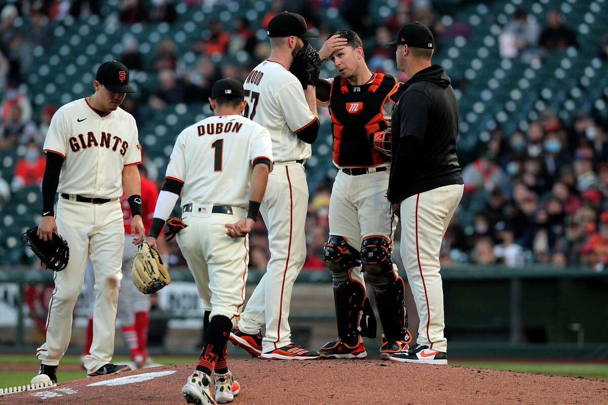 Alex Wood talks to pitching coach Andrew Bailey and teammates on the mound in the fourth inning as the San Francisco Giants played the Los Angeles Angels at Oracle Park in San Francisco, Calif., on Tuesday, June 1, 2021.