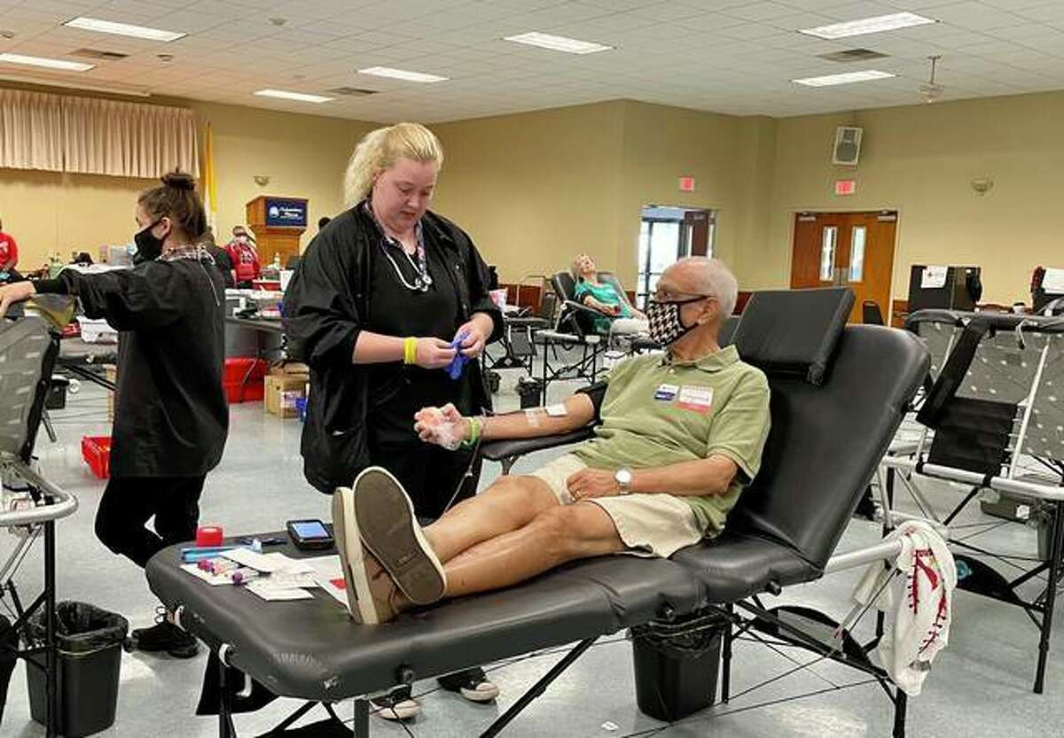 Level two collection specialist Bria Haithcoat moniters Mohamed Saler, of O'Fallon, as he donates blood.