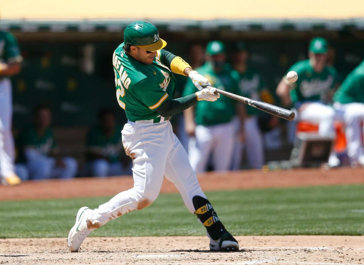 OAKLAND, CALIFORNIA - MAY 26: Ramon Laureano #22 of the Oakland Athletics hits an RBI single in the bottom of the fourth inning against the Seattle Mariners at RingCentral Coliseum on May 26, 2021 in Oakland, California. (Photo by Lachlan Cunningham/Getty Images)