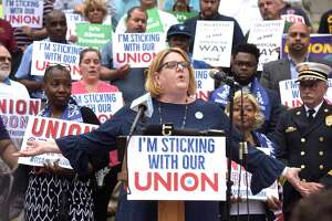 Kate Dias speaks during an press conference by workers and labor leaders on the steps of the Connecticut Supreme Court in response to the U.S. Supreme Court on Janus v. AFSCME Council case on June 27, 2018, in Hartford, Conn.