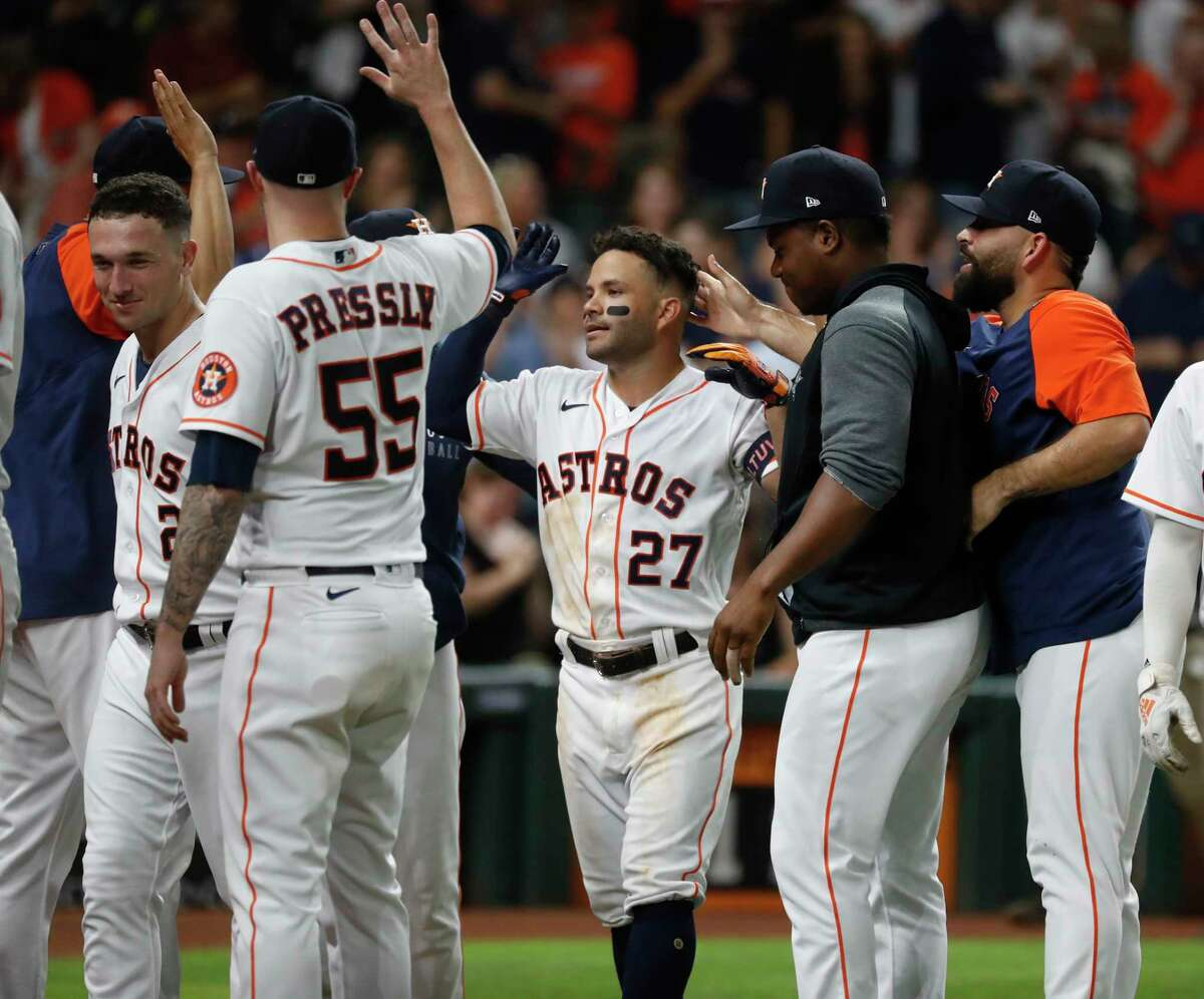 Houston Astros Jose Altuve (27) celebrates with teammates after he hit a grand slam walk off home run during the tenth inning of an MLB baseball game at Minute Maid Park, Tuesday, June 15, 2021, in Houston. Astros win 6-3 over the Texas Rangers.