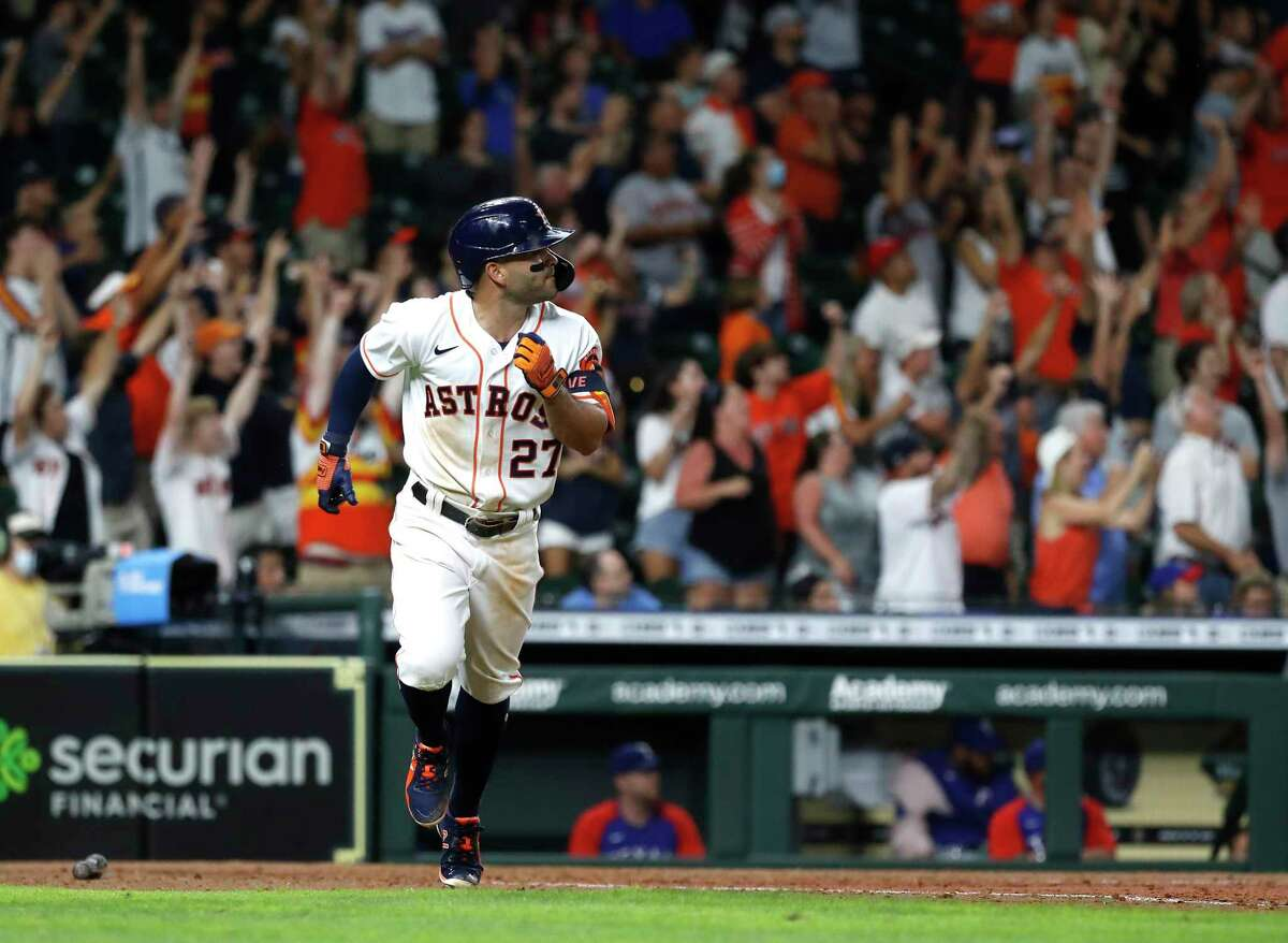 Houston Astros Jose Altuve (27) hits a grand slam walk off home run during the tenth inning of an MLB baseball game at Minute Maid Park, Tuesday, June 15, 2021, in Houston. Astros win 6-3 over the Texas Rangers.