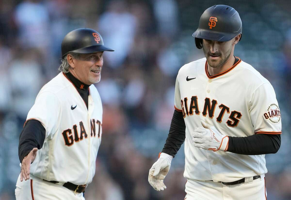 SAN FRANCISCO, CALIFORNIA - JUNE 15: Steven Duggar #6 of the San Francisco Giants is congratulated by third base coach Ron Wotus #23 after hitting a two-run home against the Arizona Diamondbacks in the bottom of the second inning at Oracle Park on June 15, 2021 in San Francisco, California. (Photo by Thearon W. Henderson/Getty Images)