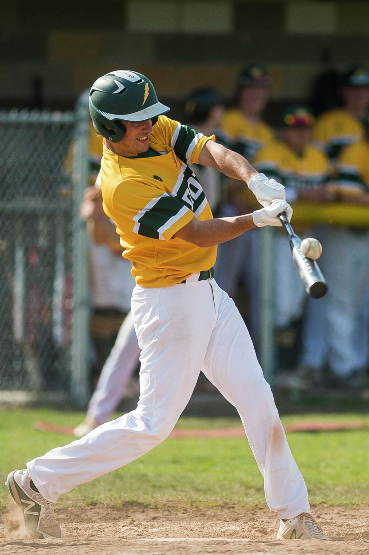 Dow High's Trent Johnson makes contact during a May 17, 2021 game against Midland High.(Daily News file photo)