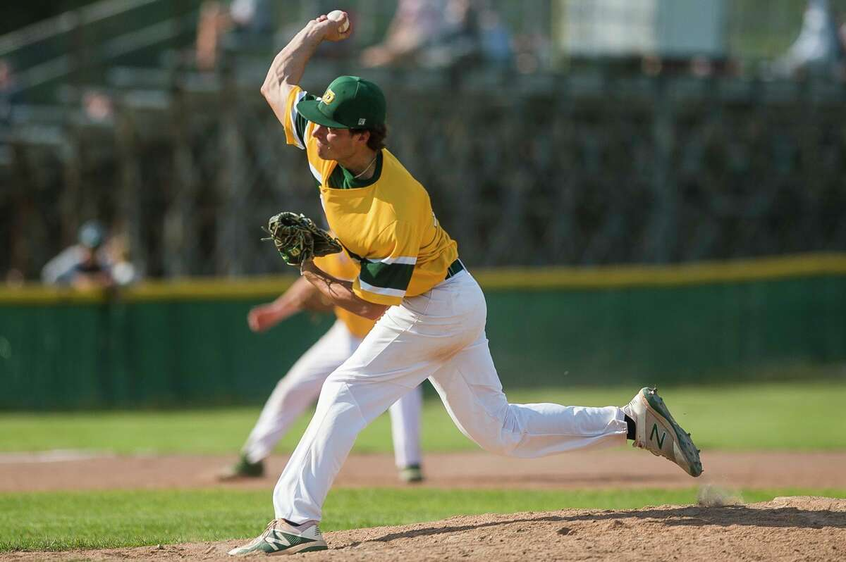 Dow High's Trent Johnson delivers a pitch during a May 17, 2021 game against Midland High.(Daily News file photo)