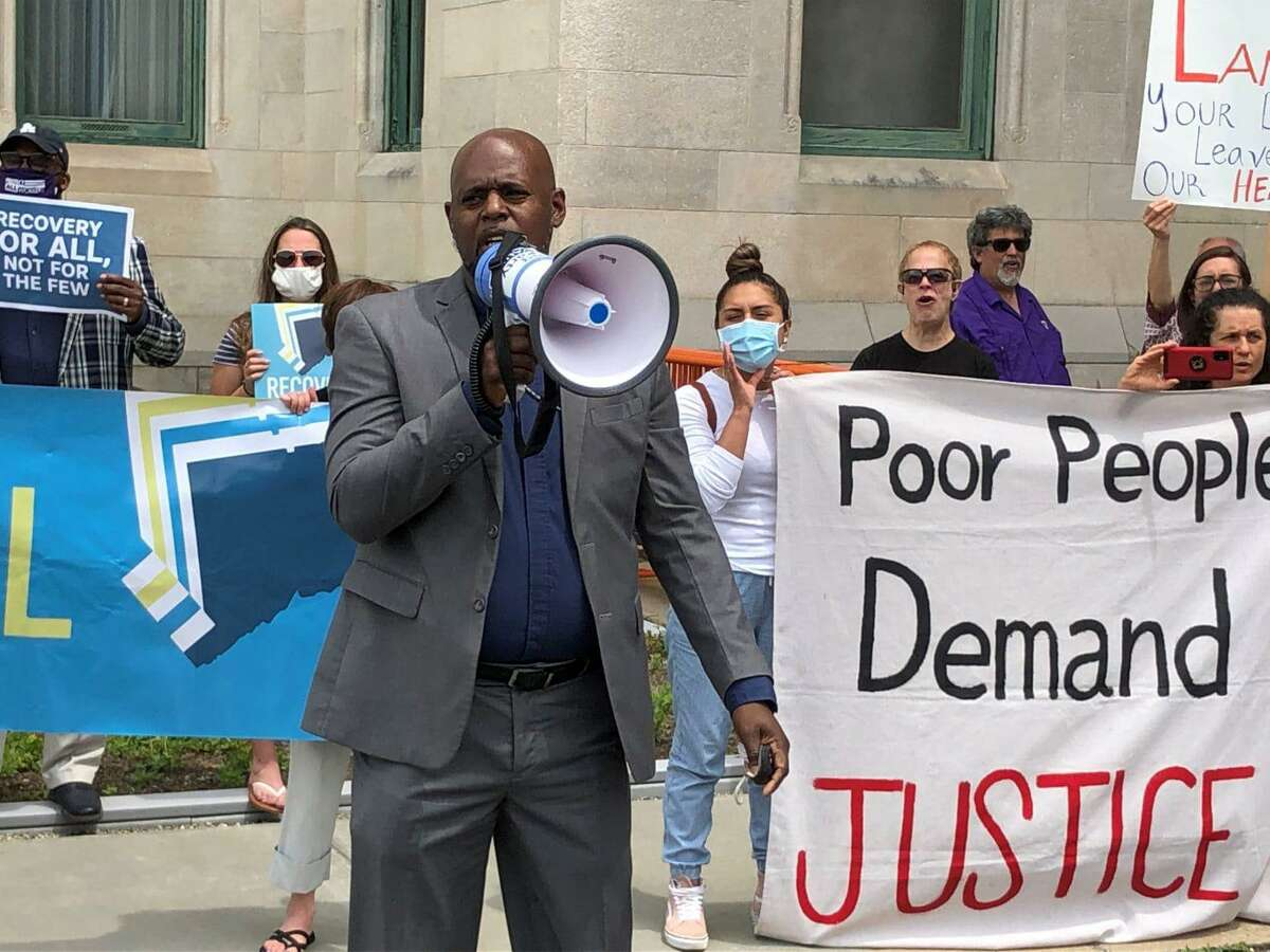 The Rev. Rodney Wade, pastor of the Long Hill Bible Church in Waterbury, speaks during a rally of faith and labor leaders outside of the Capitol earlier this month