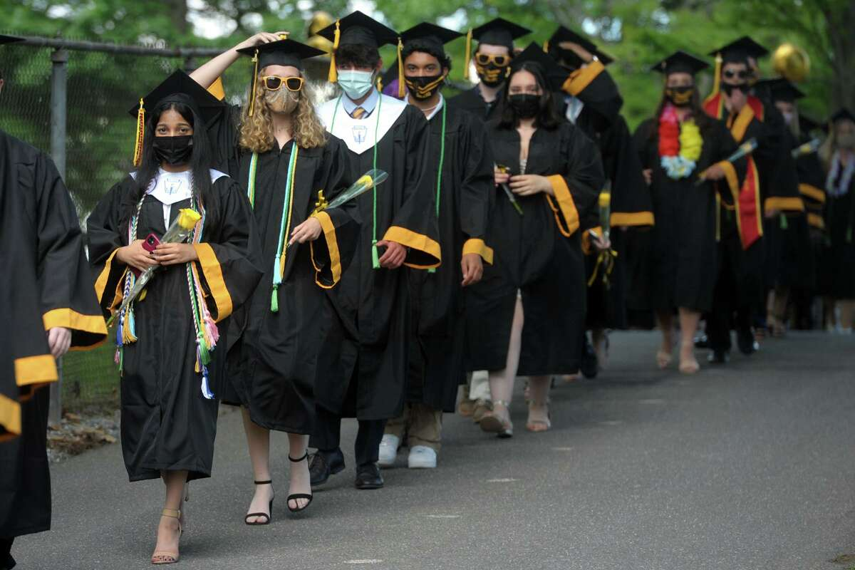 Members of the Jonathan Law High School Class of 2021 enter their graduation ceremony.