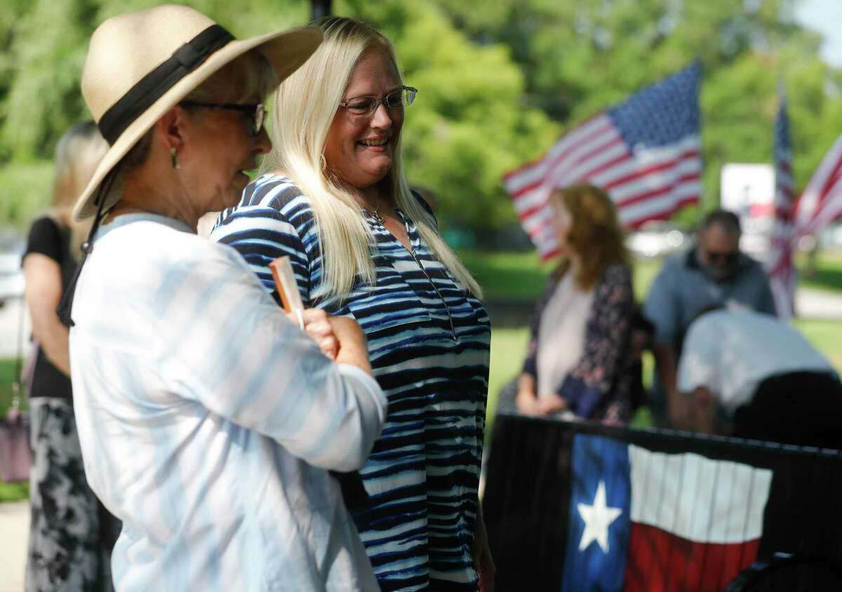 Candace Douglas, second from left, looks over one of two Texas-themed benches given in honor of her parent's contributions to Cedar Brake Park, Tuesday, June 15, 2021, in Montgomery.