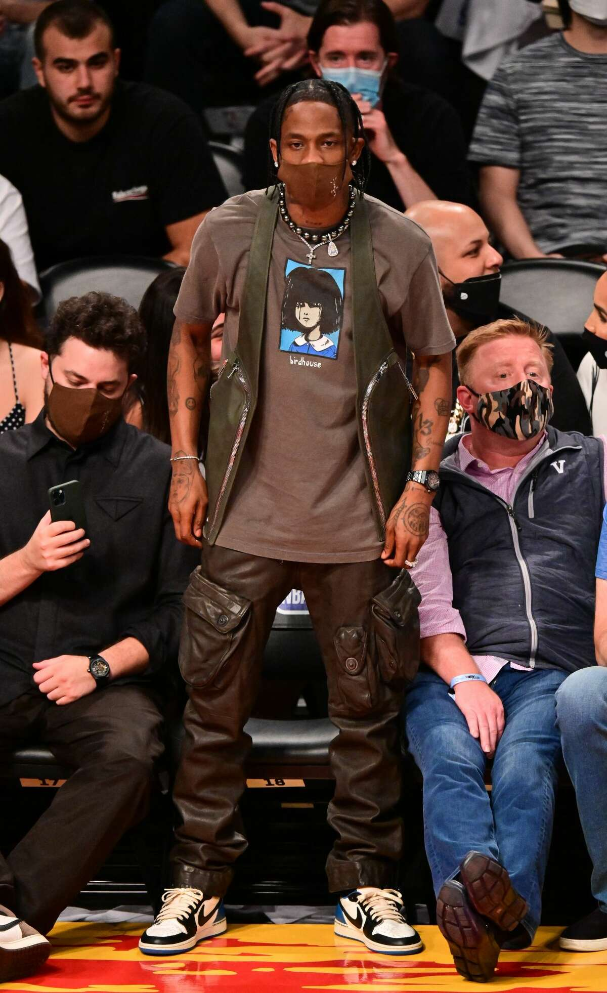 Travis Scott attends Brooklyn Nets v Milwaukee Bucks game at Barclays Center of Brooklyn on June 15, 2021 in New York City. (Photo by James Devaney/Getty Images)