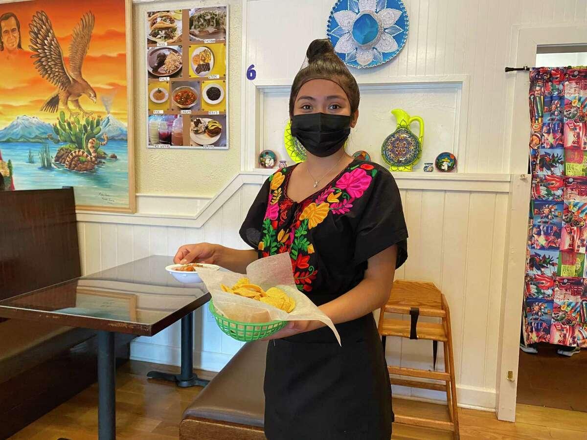 A waitress serving tacos