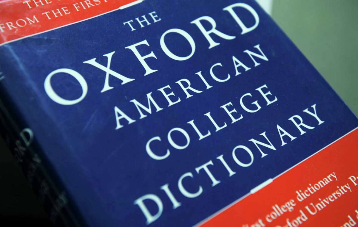 View of the Oxford American College dictionary taken in Washington on November 16, 2009. (Photo credit should read NICHOLAS KAMM/AFP via Getty Images)