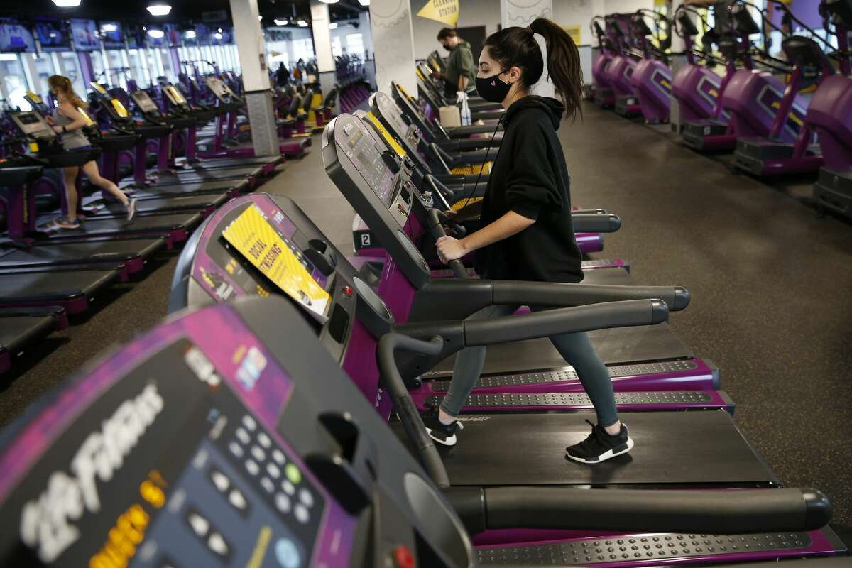 A person works out at Planet Fitness.