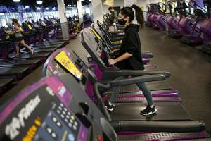 BOSTON - FEBRUARY 1: A person works out at Planet Fitness as they re-open at 25 percent capacity in Boston's Dorchester on Feb. 1, 2021. (Photo by Jessica Rinaldi/The Boston Globe via Getty Images)