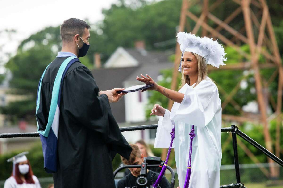 Jaylyn DiMauro accepts her diploma during Ansonia High School graduation for the Class of 2021 on June 12 2021.